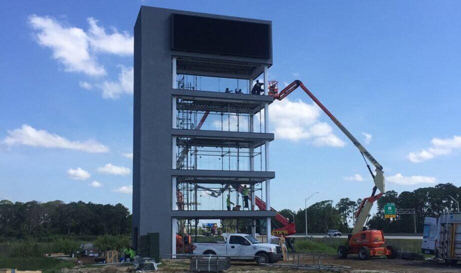 Frameless Impact Windows for New Car Tower